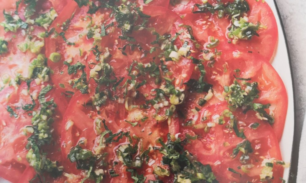 Beef tomato carpaccio with ginger and spring onion salsa